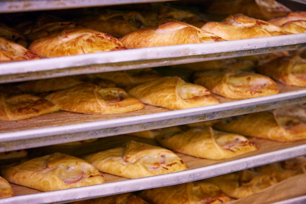 ham and cheese croissants cool on trays