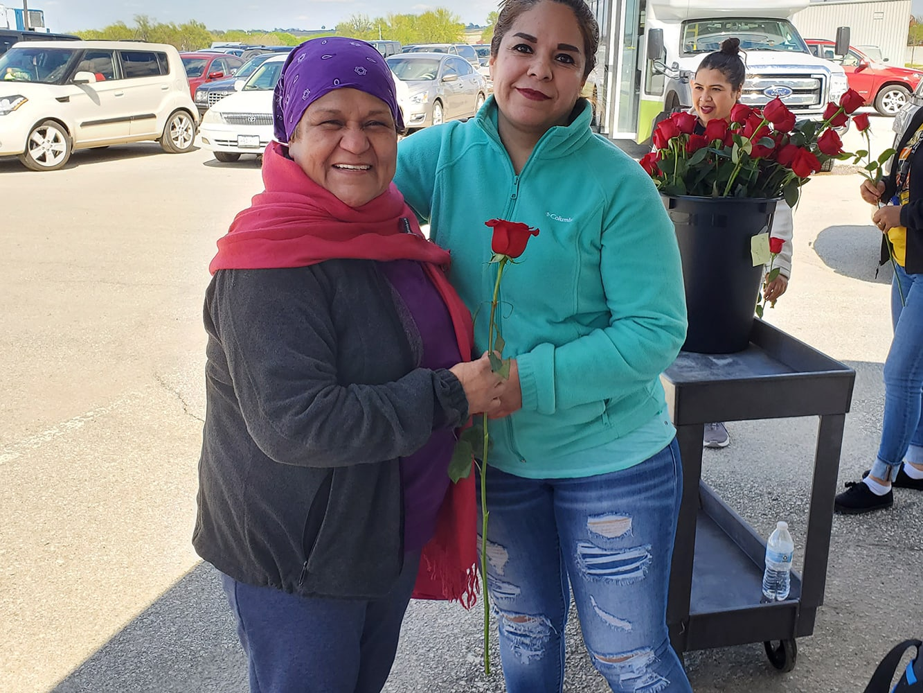 Harlan employees celebrate Mother's Day with roses