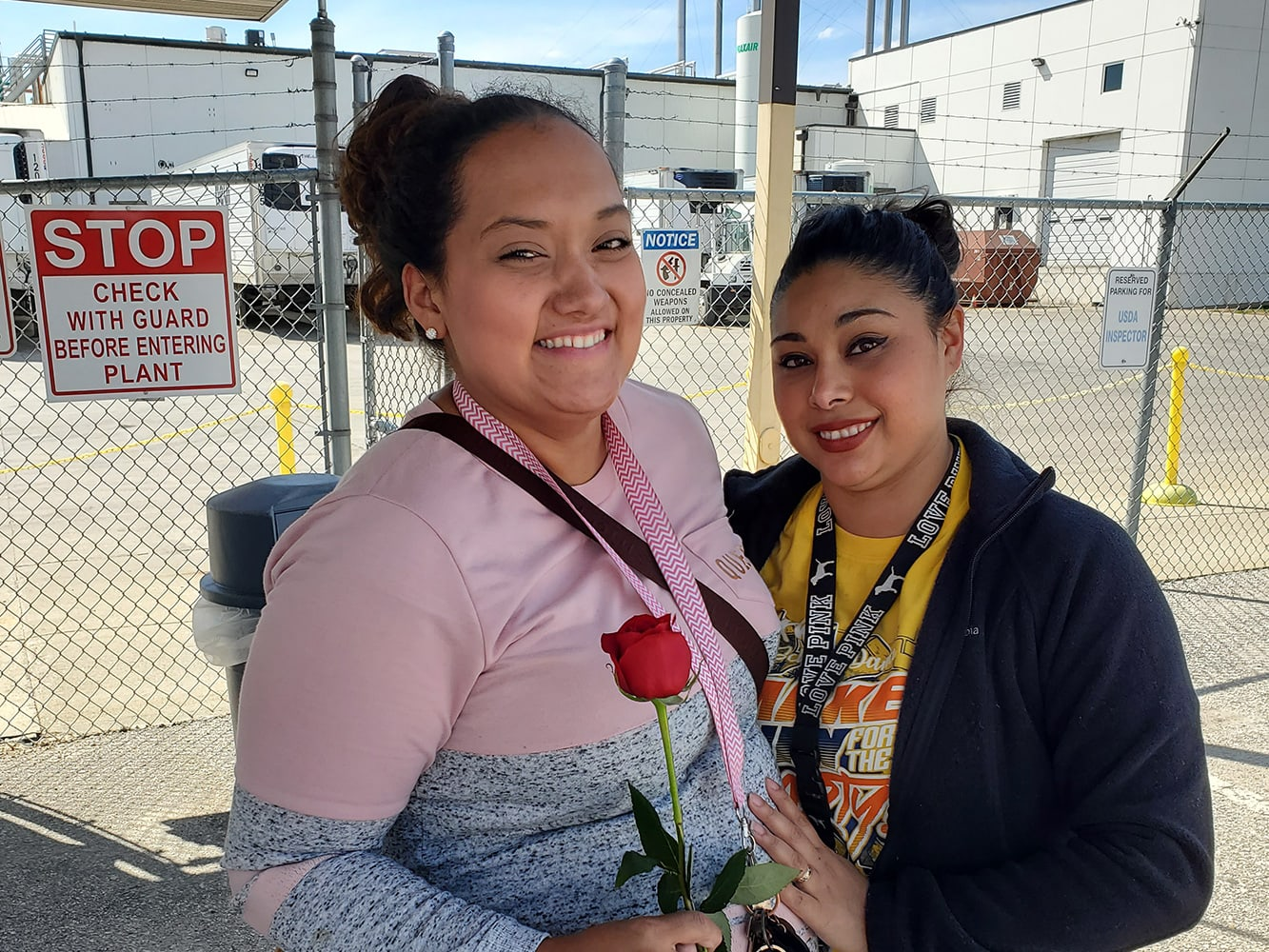 Harlan employee gives rose to a mother on Mother's Day