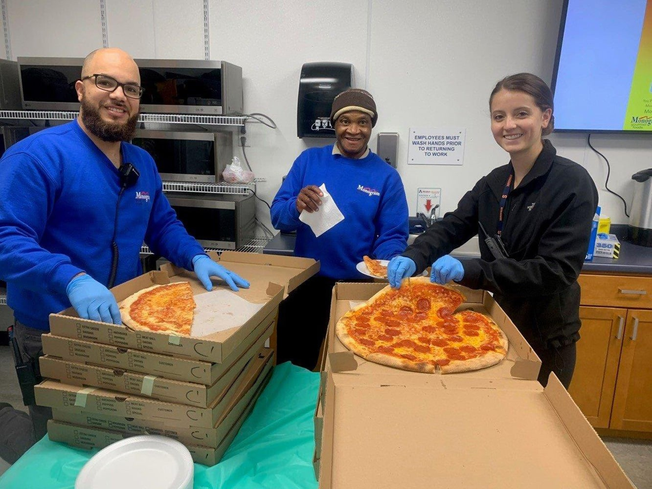 employees server pizza to staff