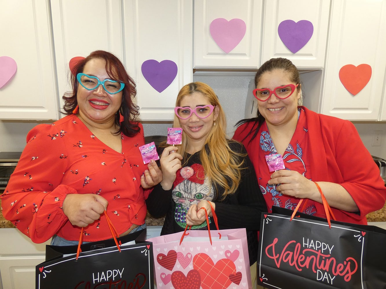 employees celebrate Valentines Day with gift bags, decorations and candy